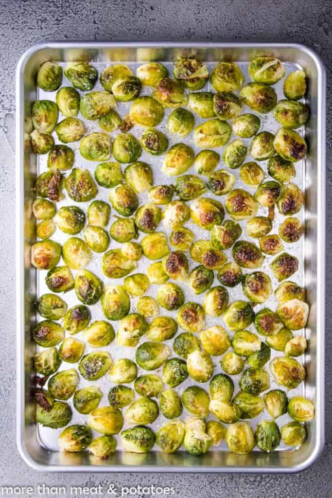 The Brussel sprouts have roasted on the sheet pan.