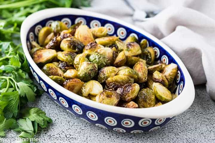 The oven roasted brussel sprouts in a serving dish.