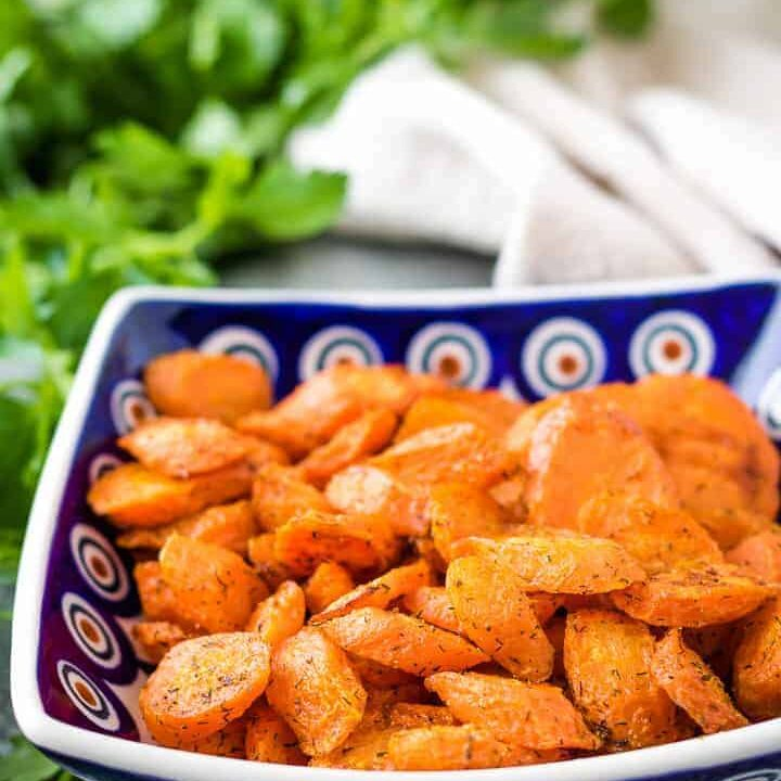 The oven roasted carrots served in a square bowl.