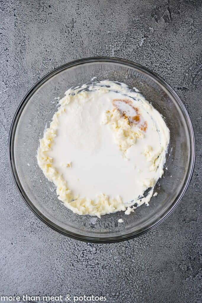 Heavy cream, champagne, and vanilla added to the cheese and sugar.