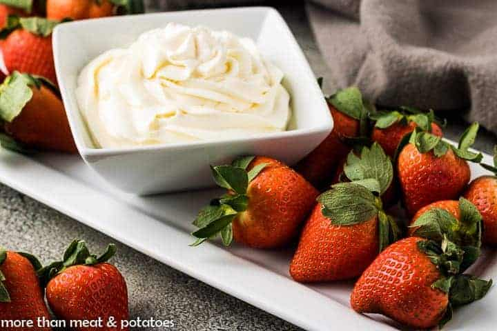 Fresh strawberries served with mascarpone whipped cream.