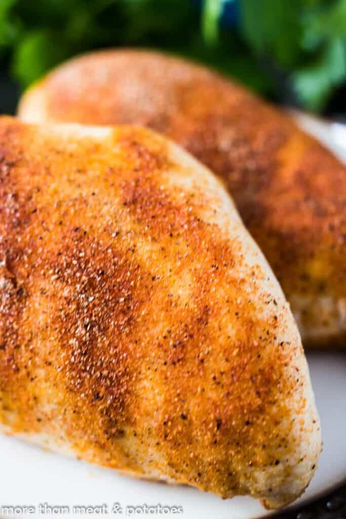 A close-up of the chicken breast showing the seasonings.