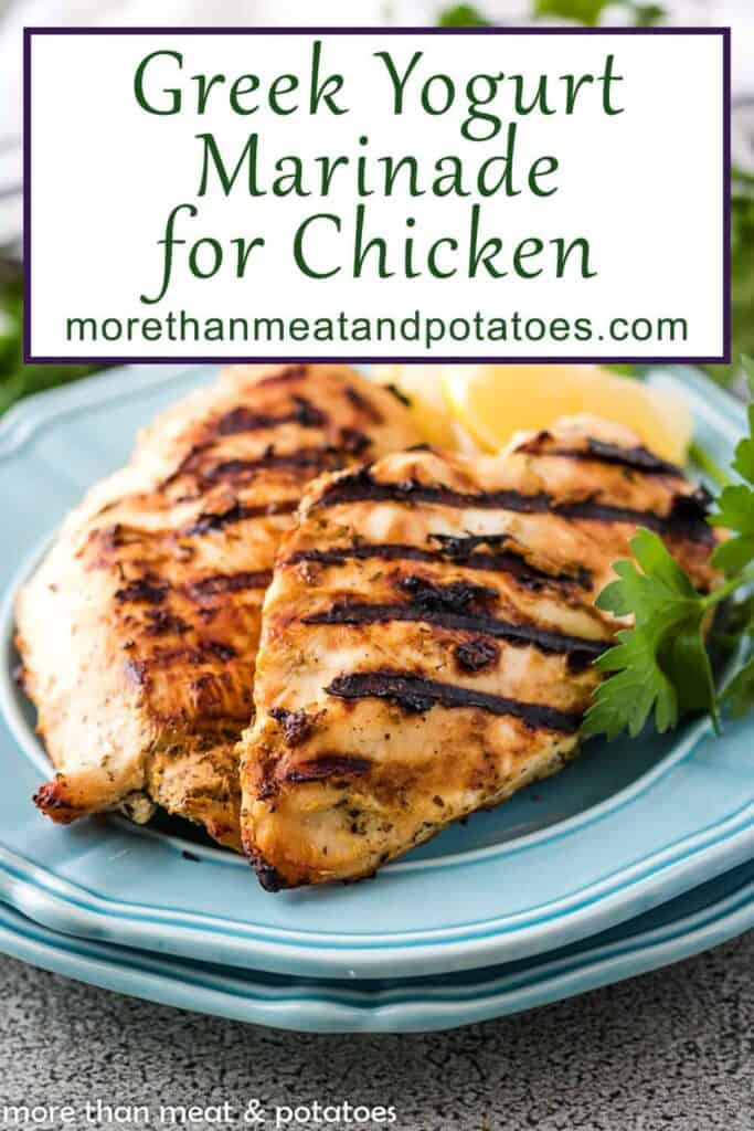 """Two blue plates with grilled chicken breasts and a box containing text """"greek yogurt marinade for chicken."""""""