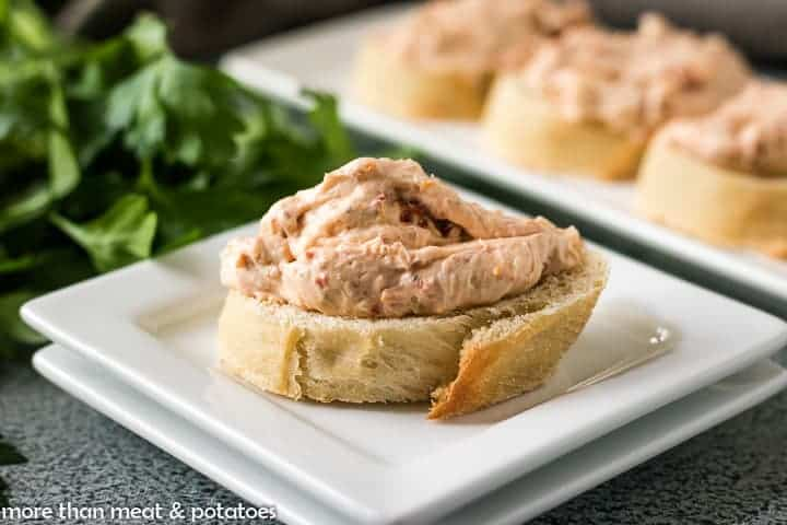 A small toasted crostini with a dab of the cream cheese filling.