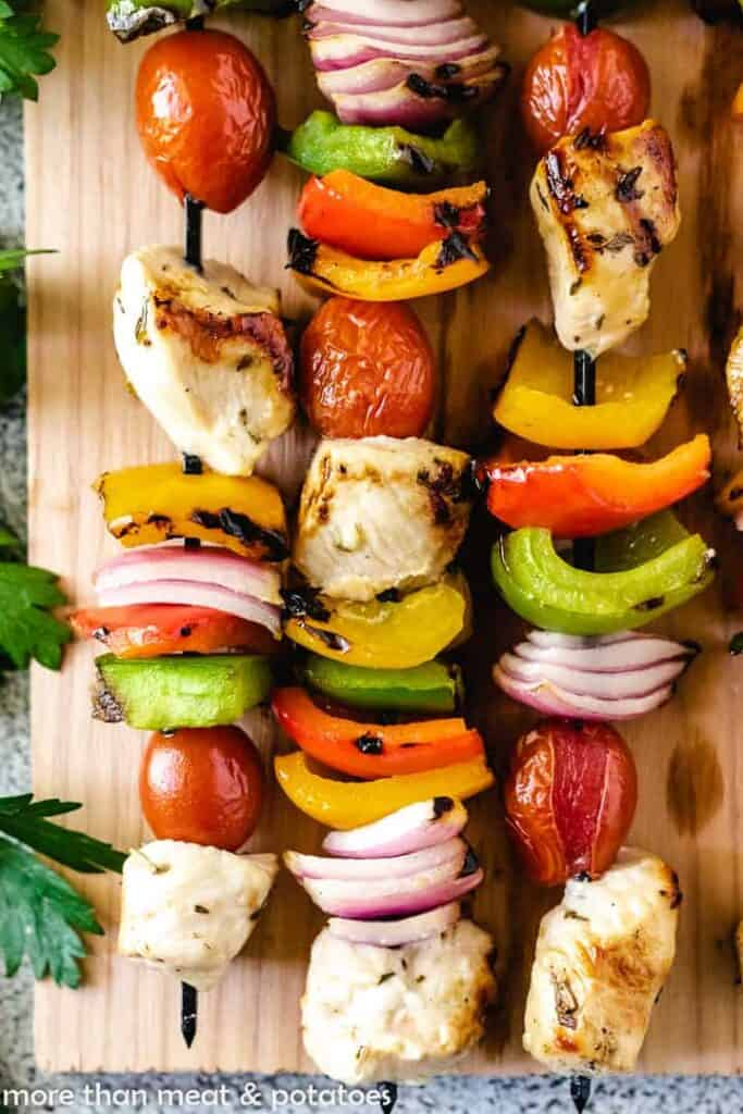 A close-up view of the colorful chicken kebabs.