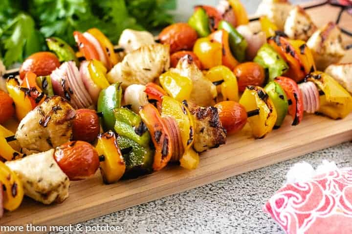 Tender grilled chicken with charred veggies on a skewers.
