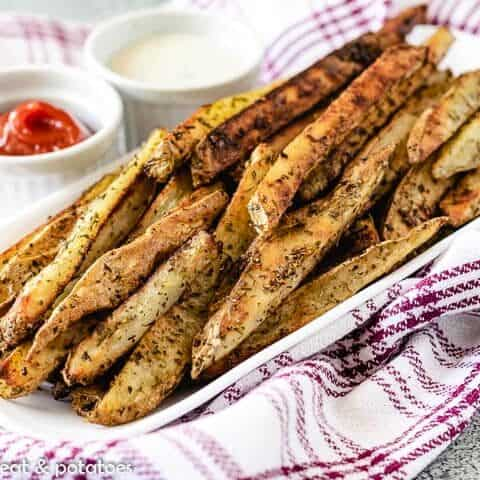 A serving platter of the seasoned oven baked French fries.