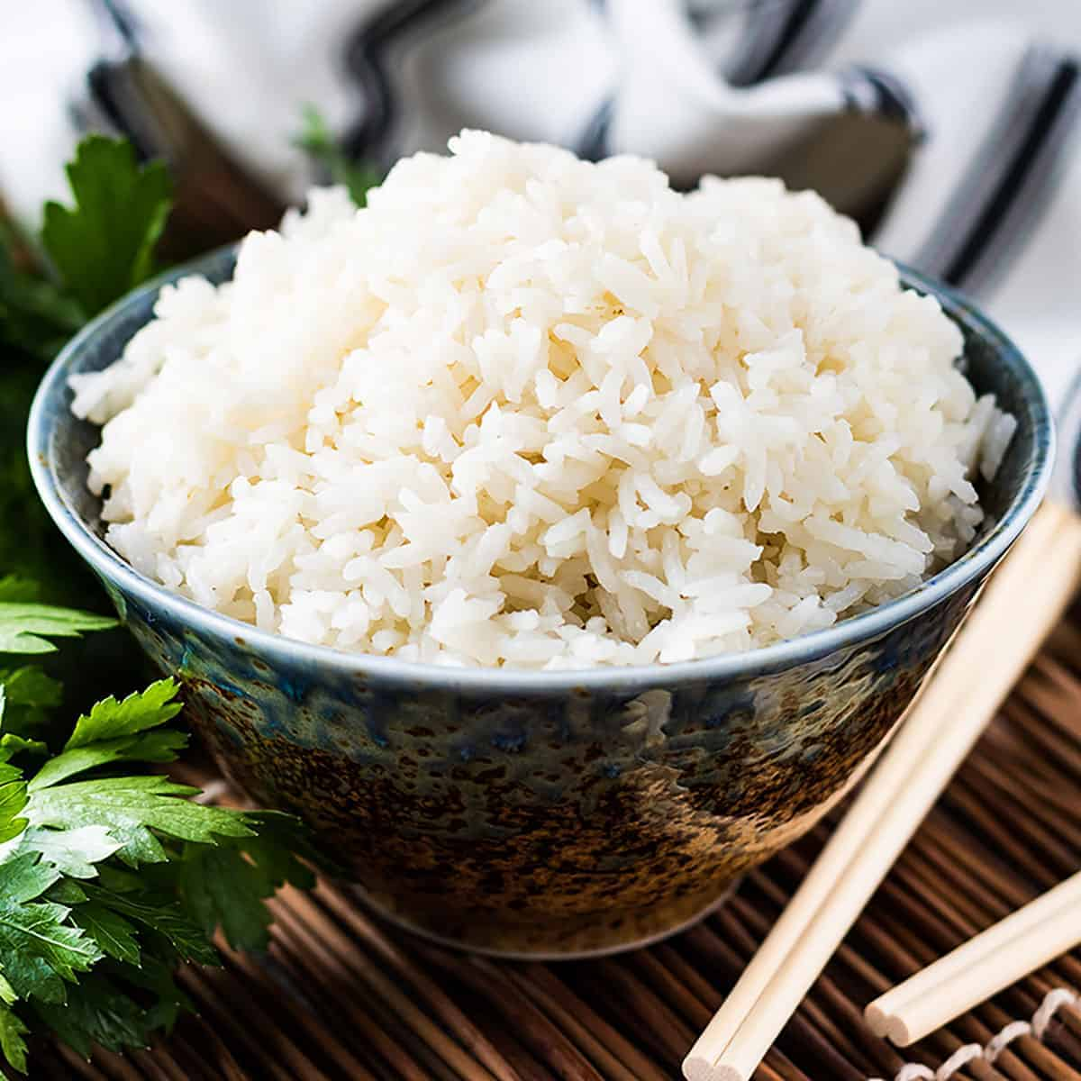 Bowl of Instant Pot coconut rice next to chop sticks.