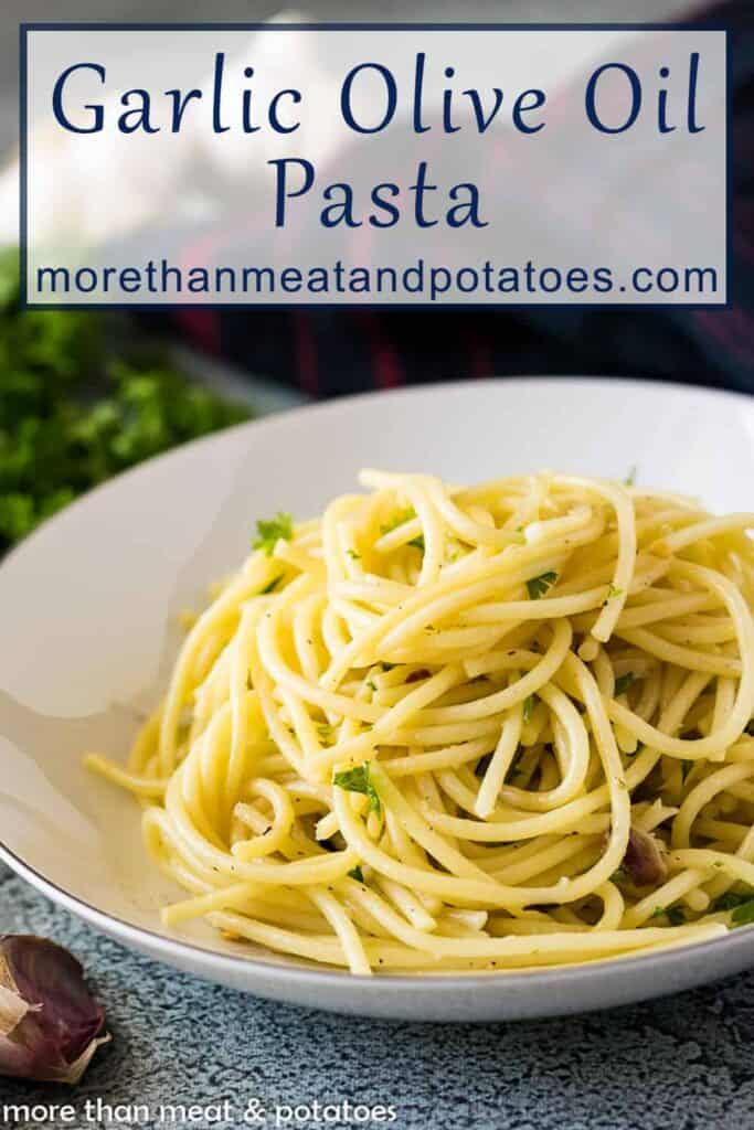 Roasted garlic and olive oil spaghetti in a bowl topped with parsley.