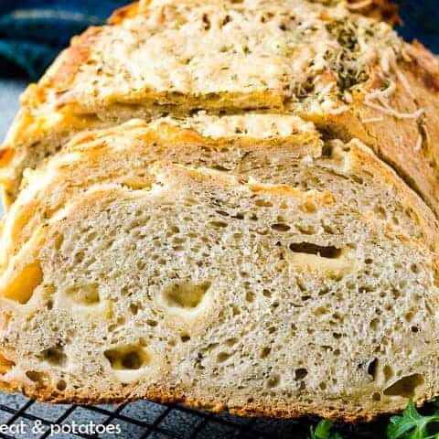 The sliced rosemary Parmesan bread on a cooling rack.