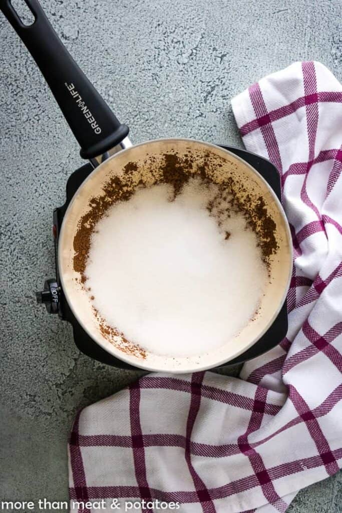 Cocoa, sugar, and other ingredients in a large saucepan.