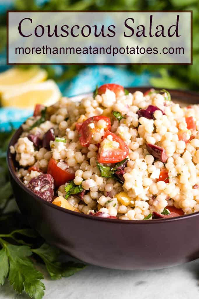 A close-up of the lemon couscous salad showing the tomatoes and olives.