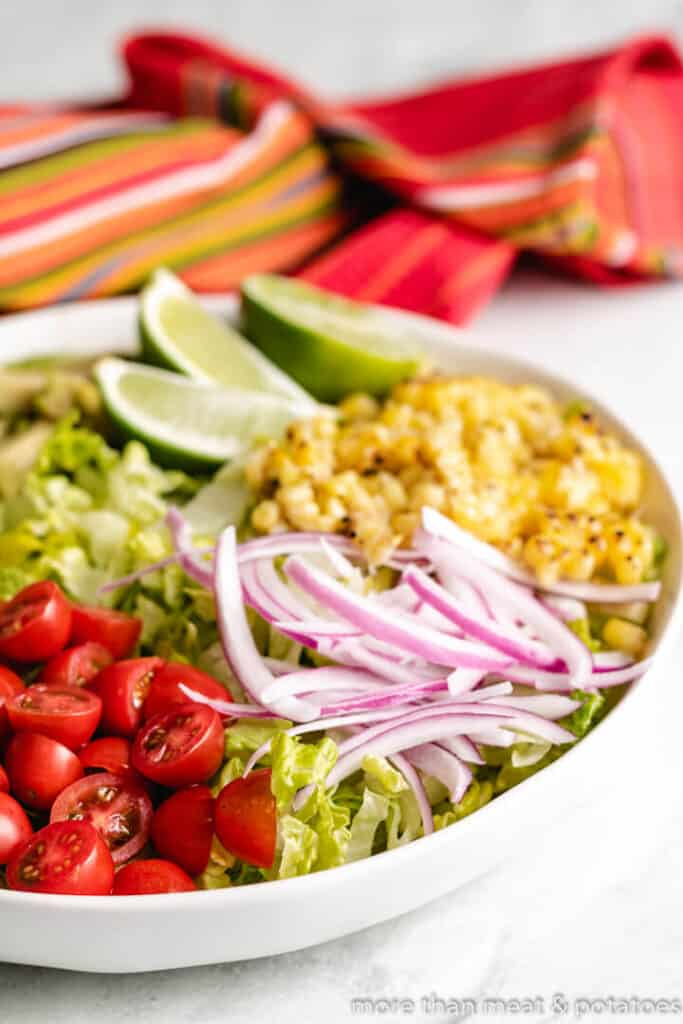 Grilled corn kernels and other veggies in a salad bowl.