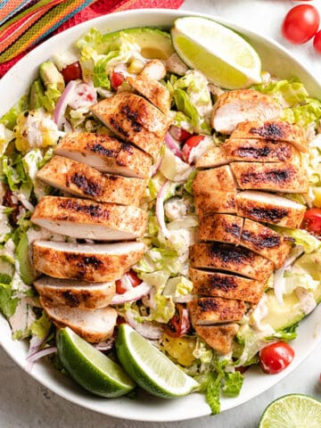 An aerial view of the grilled chicken salad in a bowl.