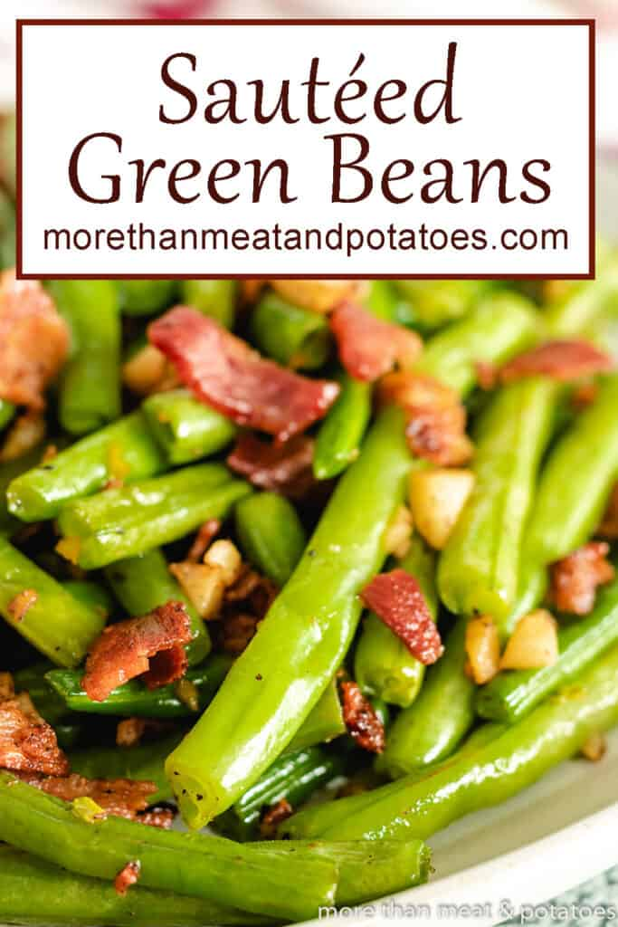 A close-up of the green beans topped with crispy bacon.