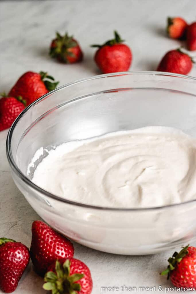 Whipping cream and other ingredients whipped in a bowl.