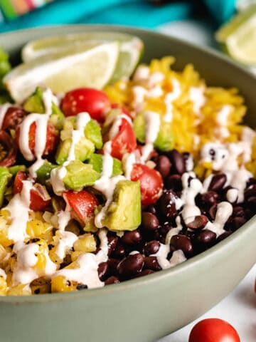 The finished vegetarian burrito bowl in a green dish.