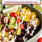 A close-up view of the vegetarian burrito bowl with chipotle sauce.