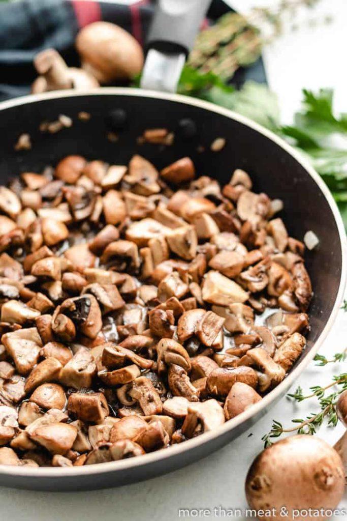 Mushrooms and garlic in a saute pan.