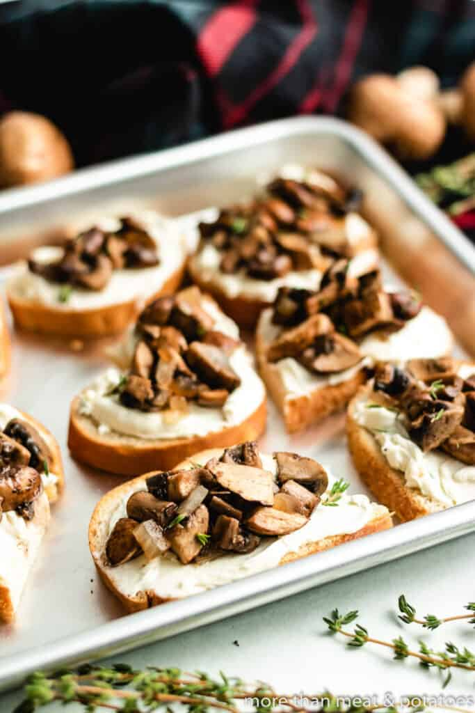 Toast topped with herb cream cheese and sauteed mushrooms.
