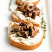 The finished mushroom toast on a rectangular plate.