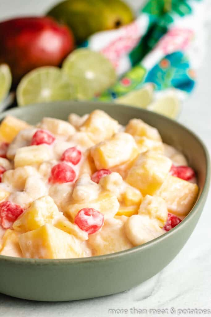 The finished tropical fruit salad with coconut dressing in a bowl.