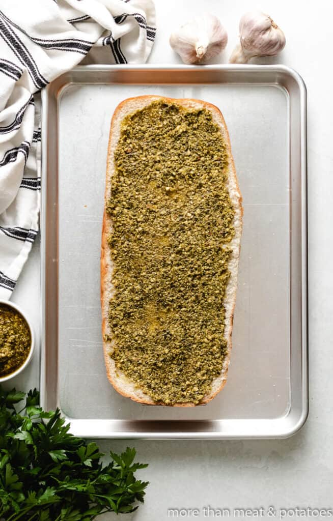 Pesto sauce spread over the loaf.