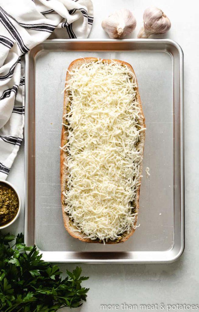 Shredded mozzarella cheese sprinkled over the sauce.