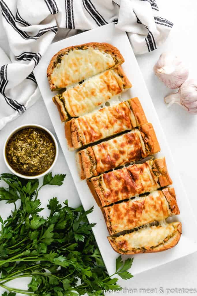 A top-view photo of the finished cheesy bread on a plate.