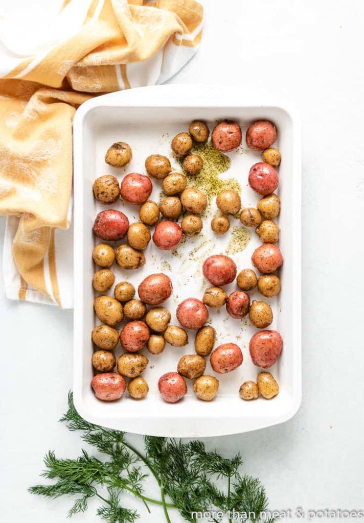 The seasoned potatoes in a baking dish.