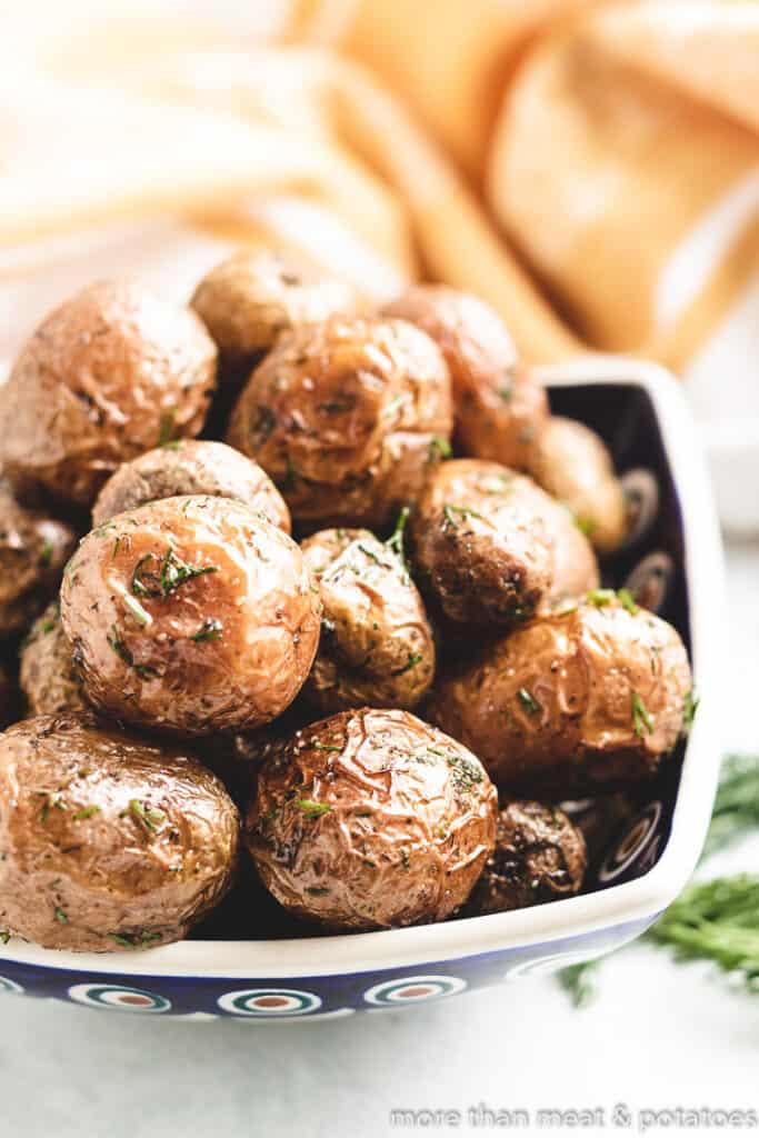 The crispy dill potatoes in a serving dish.