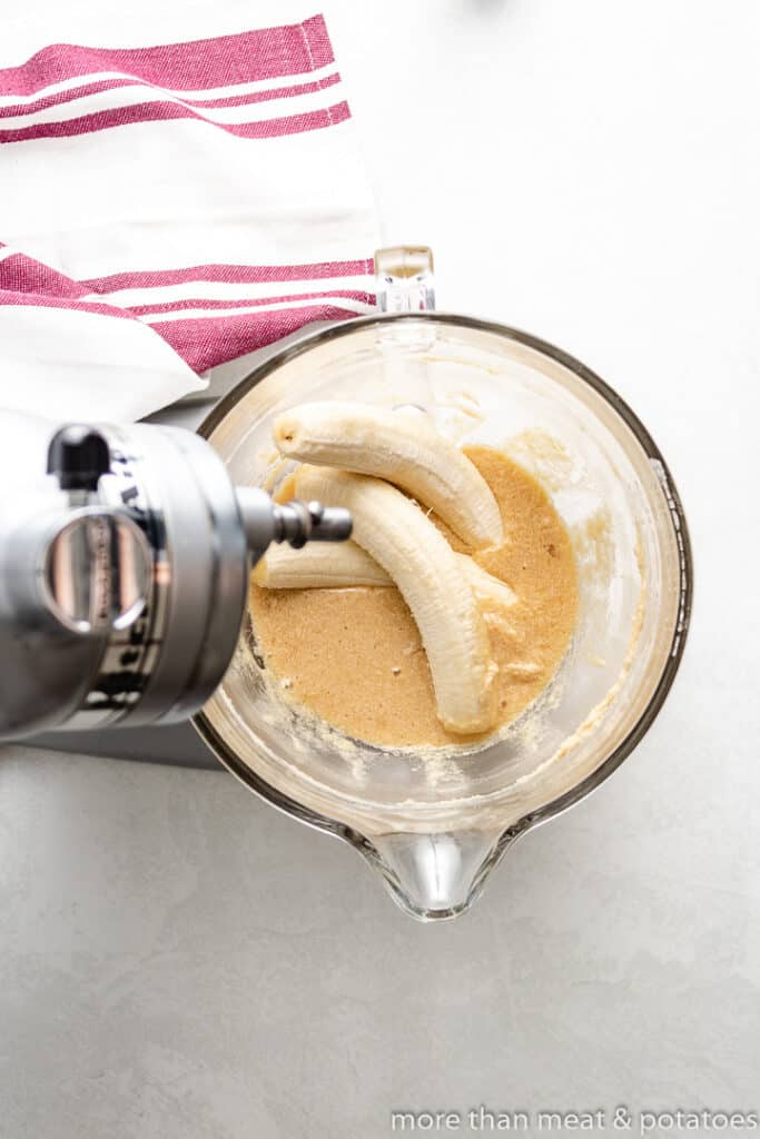 Two ripe bananas added to the mixer.
