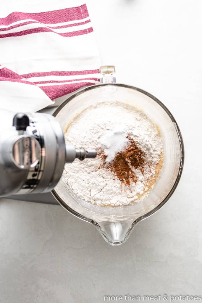 Flour added to the wet batter in the mixer.