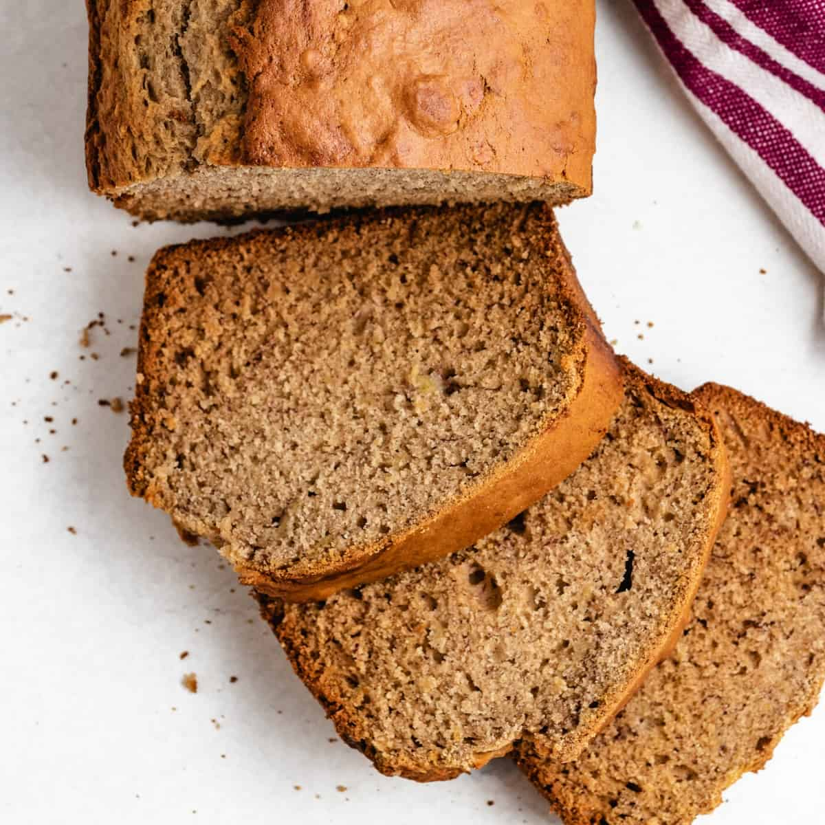 The sourdough banana bread loaf cut into slices.