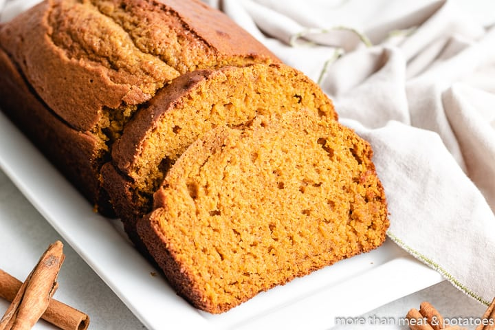 Sourdough pumpkin bread on a rectangular plate.