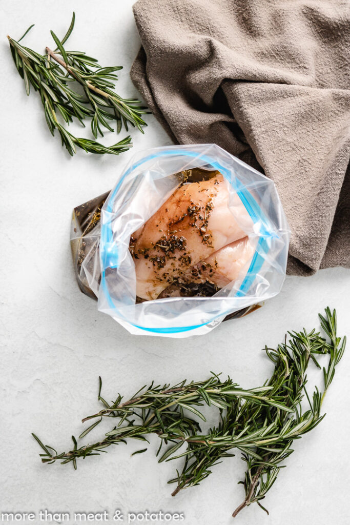 Raw chicken breasts in a freezer bag.