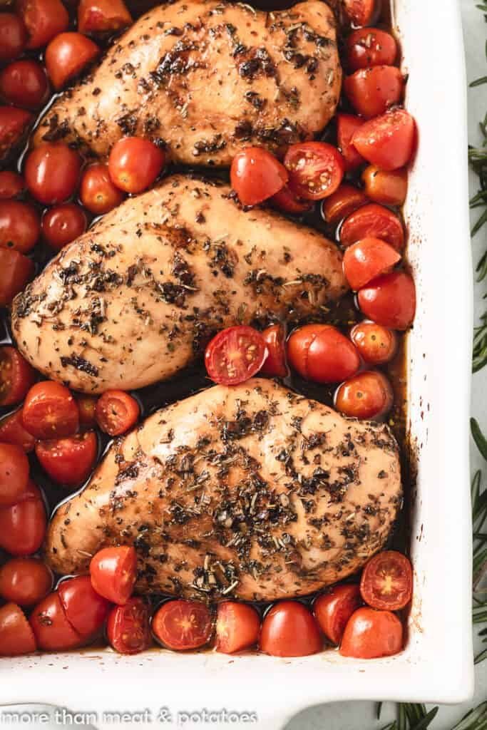 A close-up view of the balsamic roasted chicken in a pan.