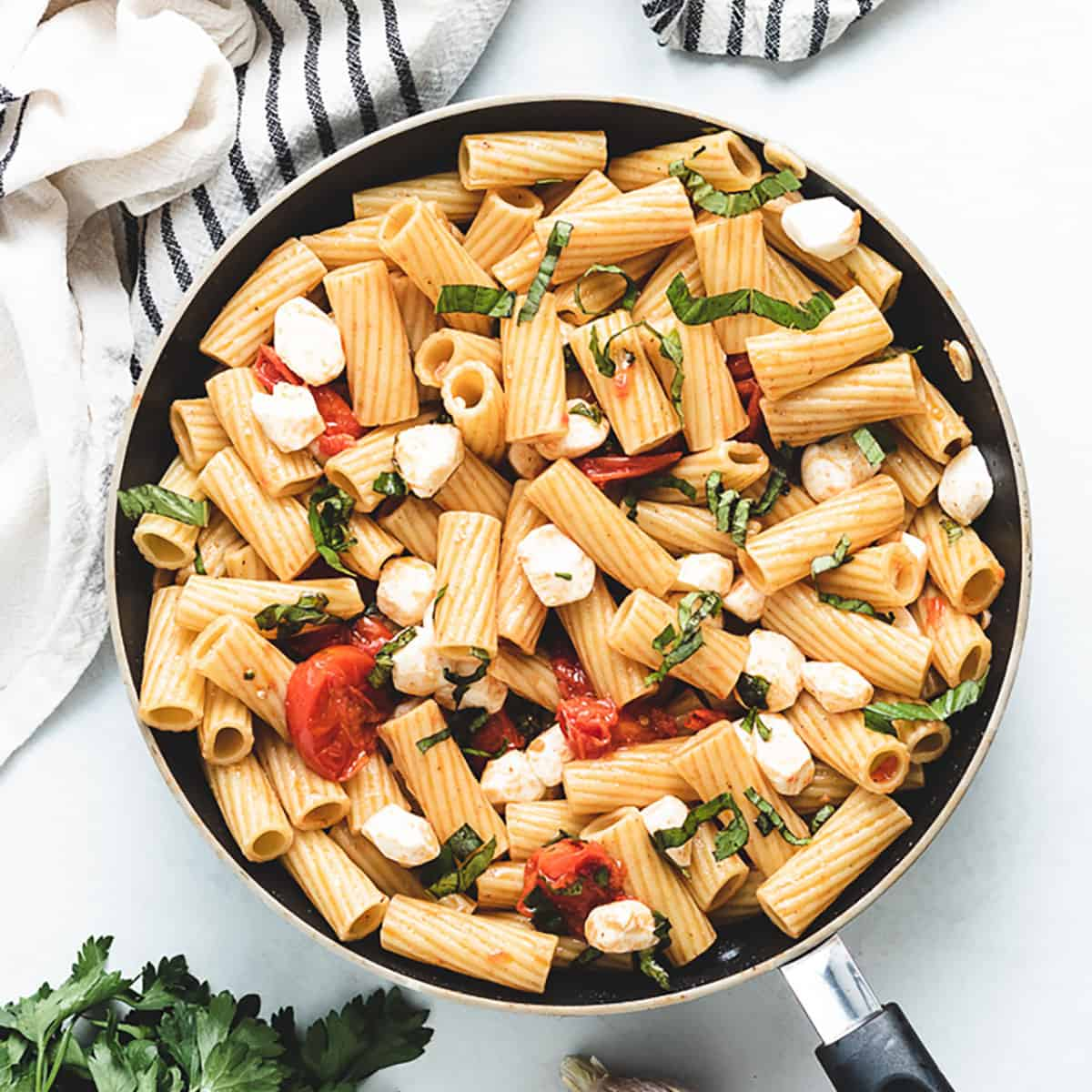 An aerial view of the rigatoni caprese in a pan.