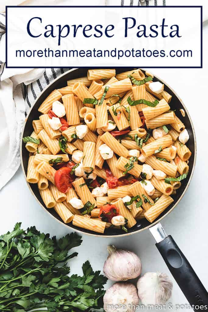 A top-view of the cooked rigatoni pasta caprese.