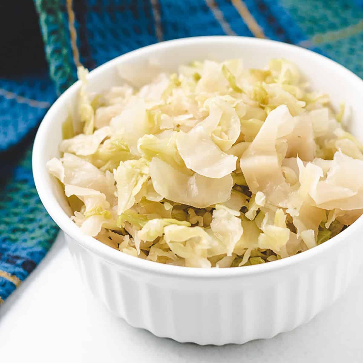 A small ramekin filed with the raw sauerkraut.
