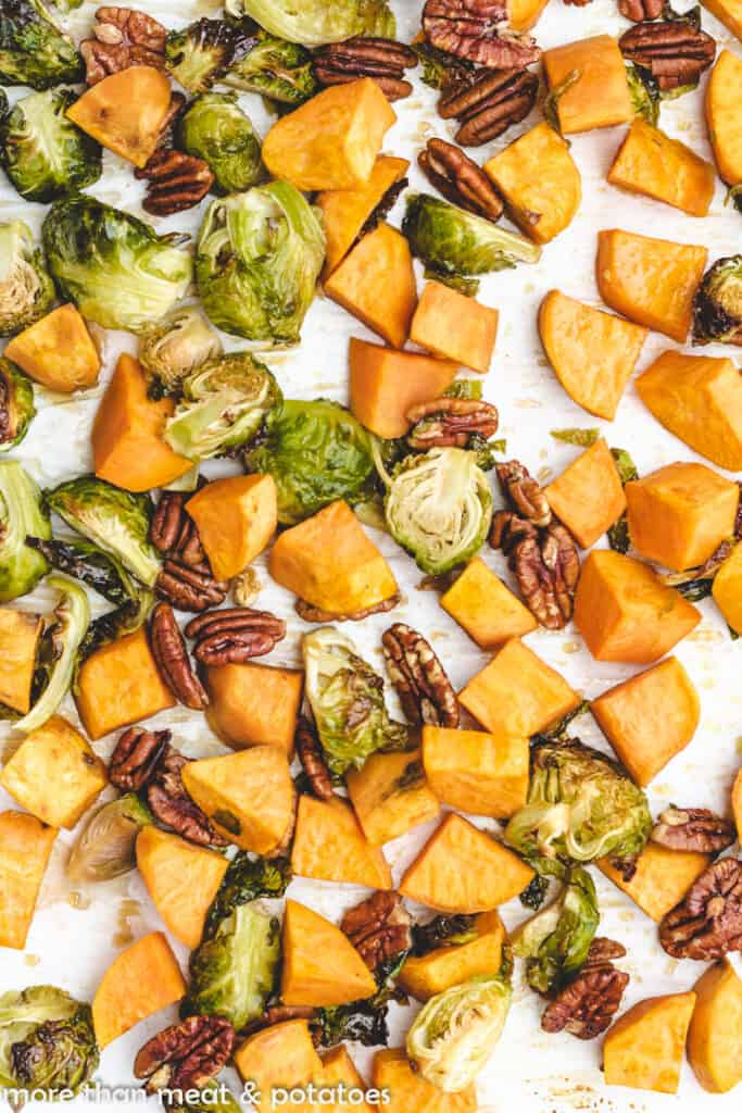 Close-up view of roasted veggies on a pan.