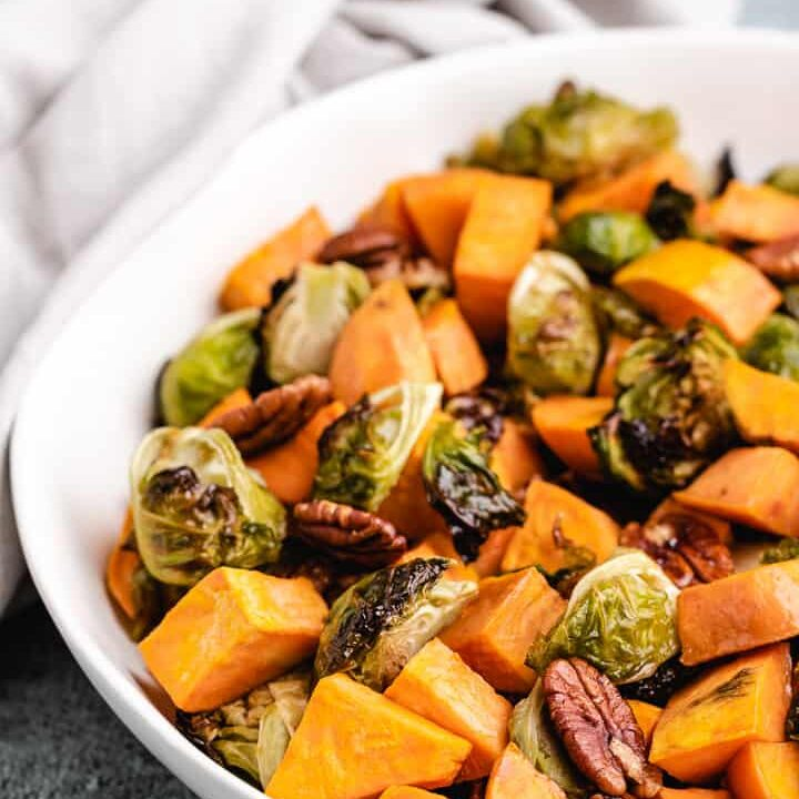 The roasted vegetables served in a decorative bowl.