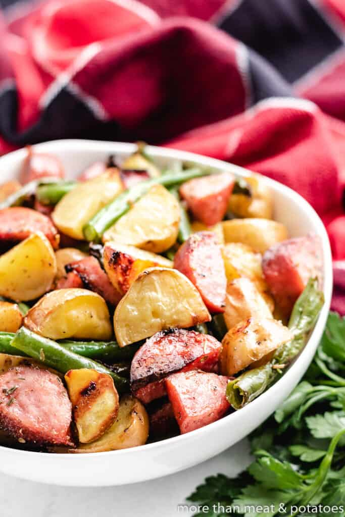 The roasted meat and vegetables in a bowl.