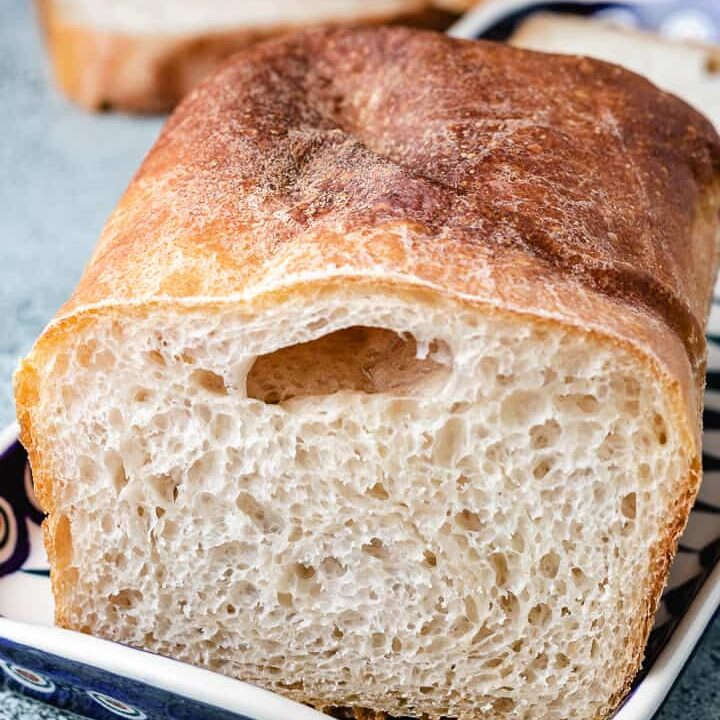 Fresh baked bread on a decorative plate.