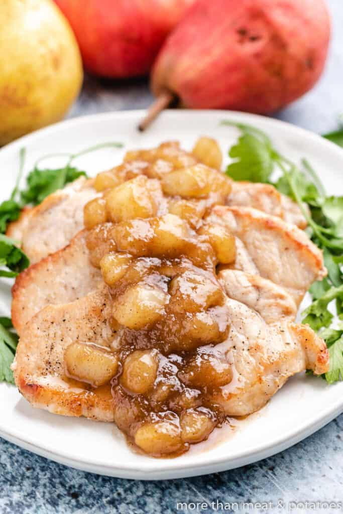 Warm pear topping served over cooked pork.