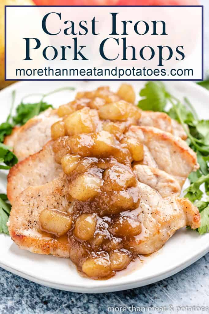 Cast iron pork chops with a pear topping on a plate.