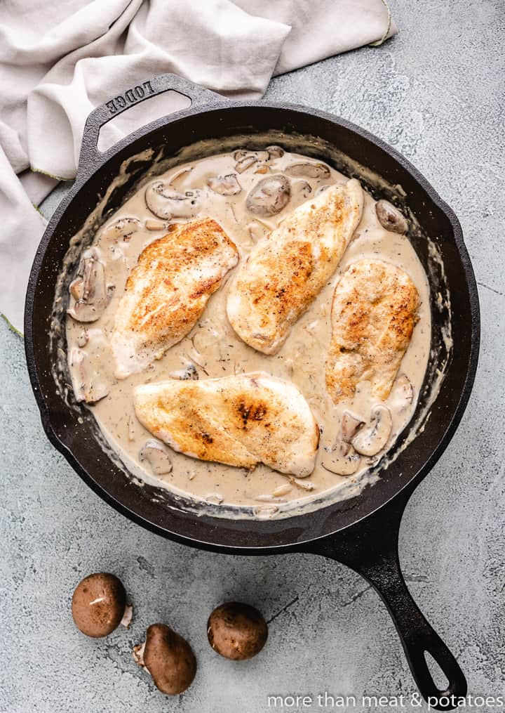 The cooked chicken add back to the skillet.