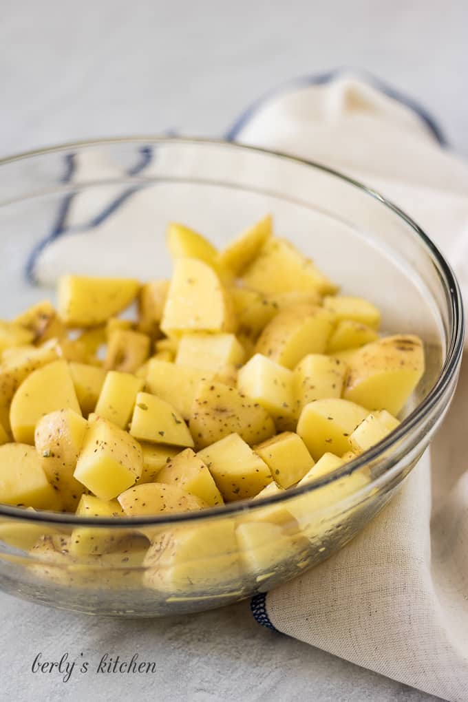 Diced gold potatoes tossed with oil and spices.