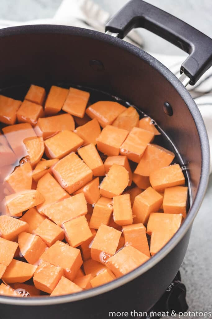 Diced potatoes in a stock pot with water.