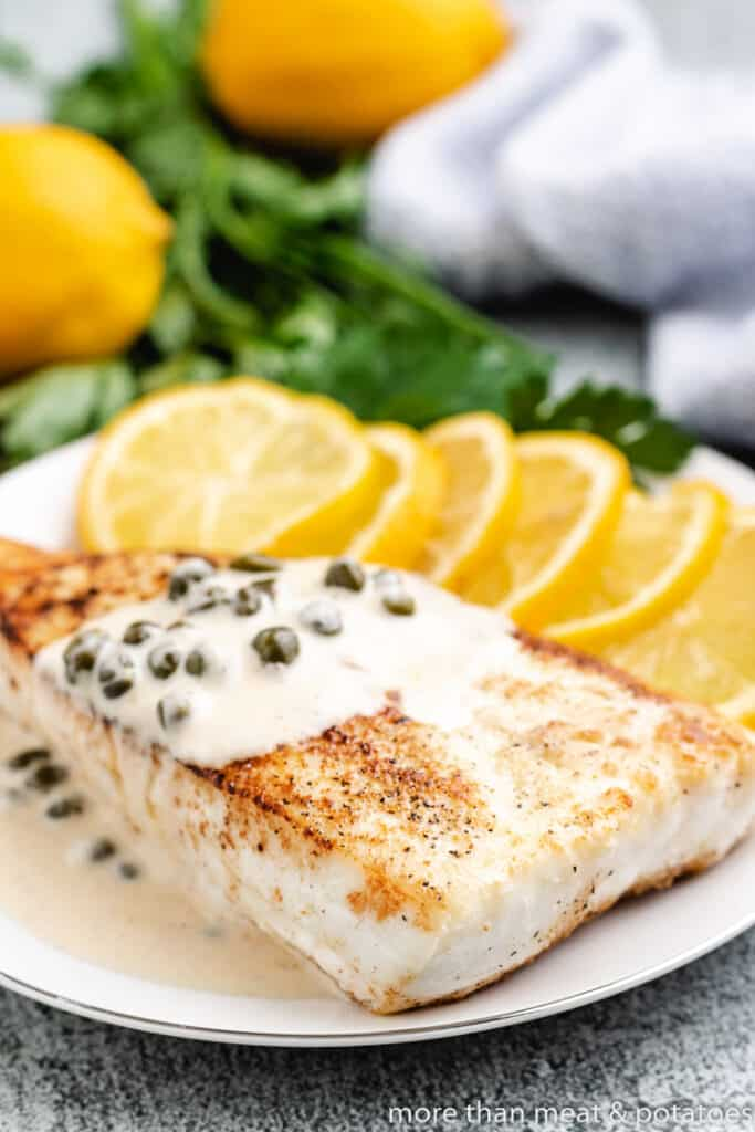 A lemon sauce served over cooked fish.